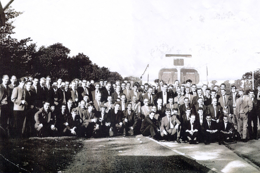 An old image of the W&H Roads staff posing for a large group photo